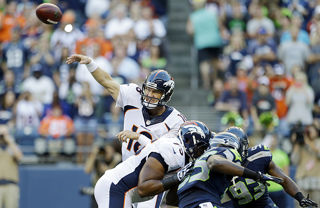 Peyton Manning (top) and his record-setting offense will face Seattle's league-best D in the Super Bowl.