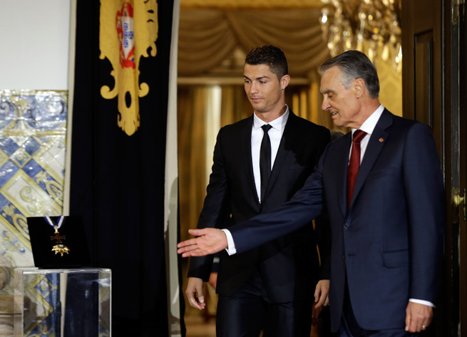 Portugal president Anibal Cavaco Silva, right, presents Cristiano Ronaldo with the Order of Prince Henry honor at the Belem presidential palace in Lisbon.