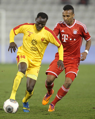 Julian Green, right, defends against Balla Jabir of Al-Merrikh during their friendly at Al-Saad stadium on Jan. 9.