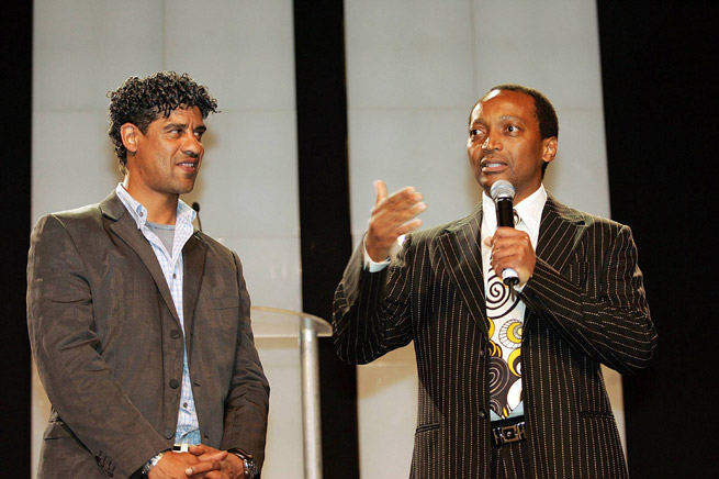 Mamelodi Sundowns current owner Patrice Motsepe talks next to former FC Barcelona manager Frank Rijkaard prior to a friendly between the two clubs in South Africa in 2007.