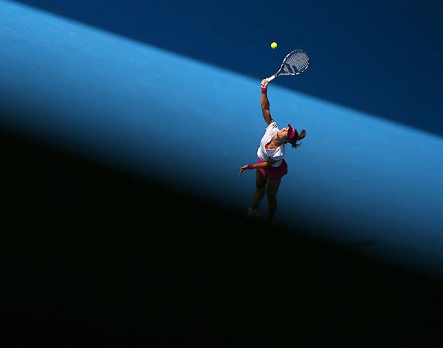 Li Na of China serves during her second- round match against Belinda Bencic during the third day of the Australian Open. Na won in straight sets, 6-0, 7-6.