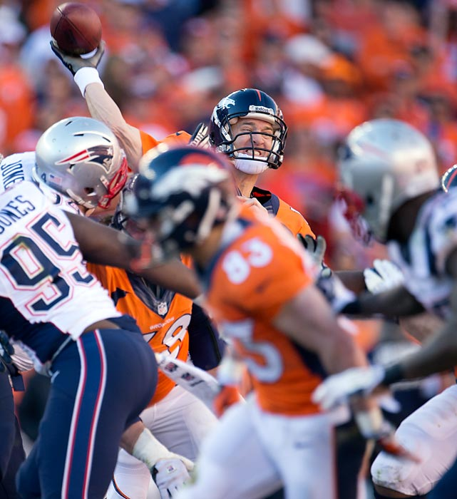 Denver quarterback Peyton Manning attempts a pass against the New England Patriots during Sunday's AFC Championship game. Manning finished the game 32-of-43 with 400 yards and two touchdowns, leading Denver to its first Super Bowl appearance since the 1998 season.