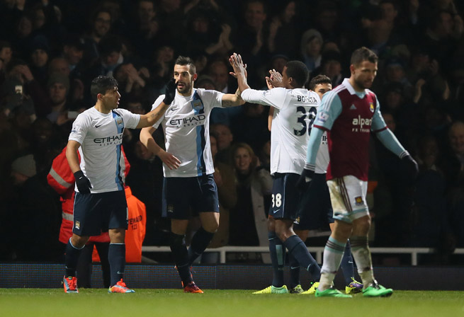 Alvaro Negredo, second left, celebrates one of his two goals in Manchester City's 3-0 win over West Ham in their League Cup semifinal second leg. Negredo scored five times in City's 9-0 aggregate rout.