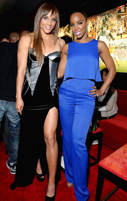 "Jones and singer Kelly Rowland at ESPN The Magazine's ""NEXT"" Event Super Bowl party in New Orleans."