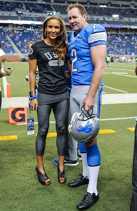 Jones poses with Detroit punter Ben Graham before a Lions-Rams game at Ford Field in Detroit.