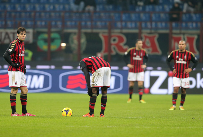 AC Milan players, including Kaka, far left, look on in dismay after conceding a goal in a 2-1 Italian Cup loss to Udinese.