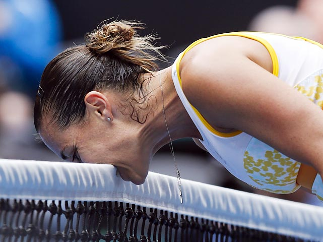 Flavia Pennetta stops for a bite during her match against Angelique Kerber. Pennetta won in an upset stomach, but was later chewed up by Li Na in the quarterfinals.