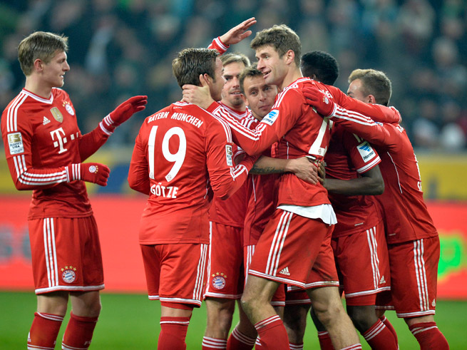 Bayern Munich celebrates after Thomas Mueller's penalty kick doubles the club's lead against Borussia Monchengladbach on Friday.