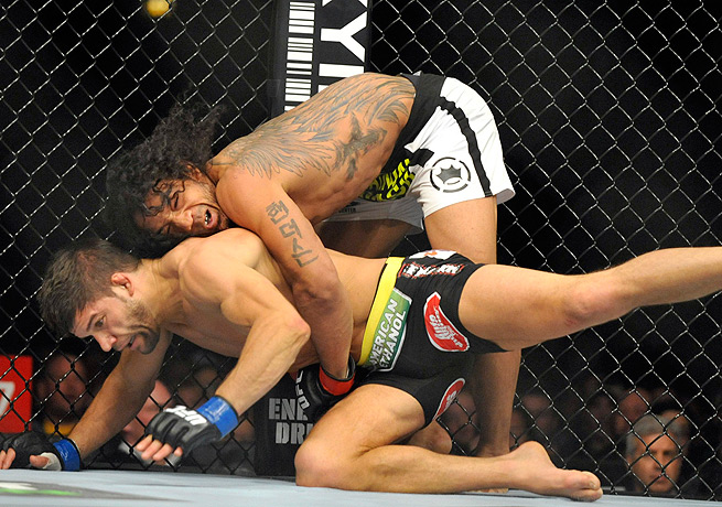 Benson Henderson (top) earned a win over Josh Thomson that wasn't without its share of controversy.