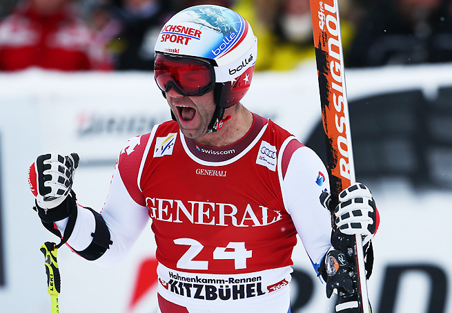 Didier Defago edged out Bode Miller in the World Cup Super G in Kitzbuehel, Austria.