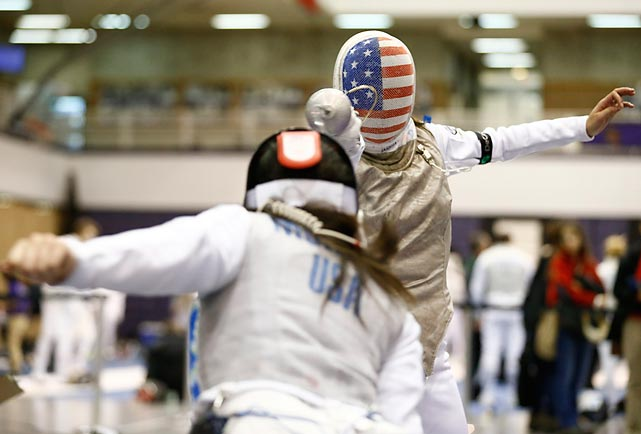 Notre Dame sophomore fencer and 2012 Olympian Lee Kiefer (back) faces off against Yale sophomore Megan Murphy (front) during Saturday's New York University Fencing Invitational. Participants included some of the nation's most high-profile teams, including Ohio State and Columbia.