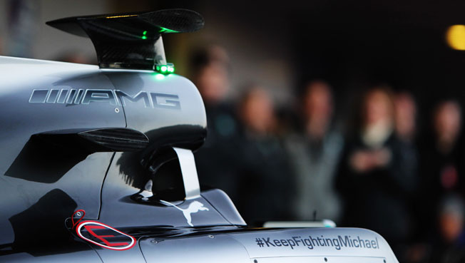 Mercedes' new F1 car bears a message for racing legend Michael Schumacher, who remains in a coma.