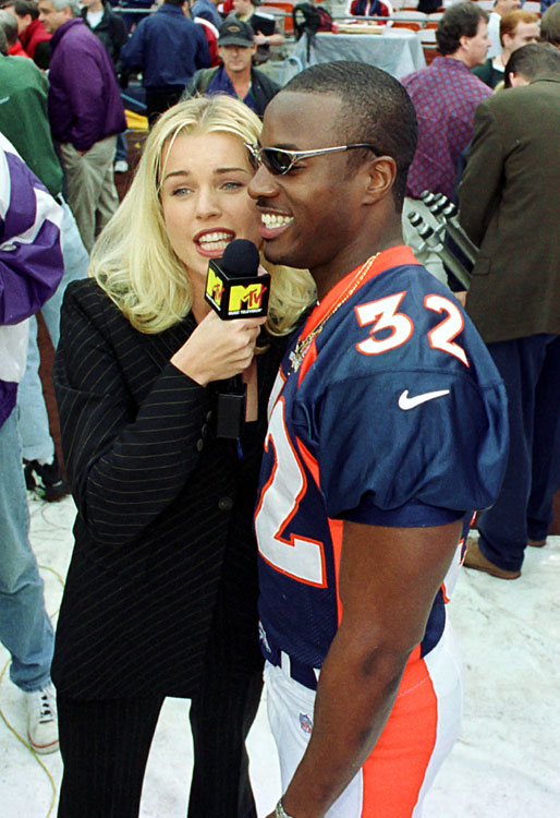 Supermodel and MTV reporter Rebecca Romijn interviews Broncos safety Tony Veland during Media Day for Super Bowl XXXII in San Diego.