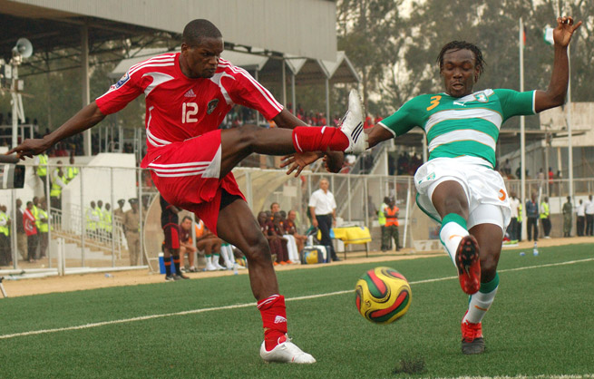 Malawi's Victor Nyirenda, left, and Ivory Coast's Arthur Boka tussle for the ball during their World Cup qualifying game in 2009 at Kamuzu Stadium.