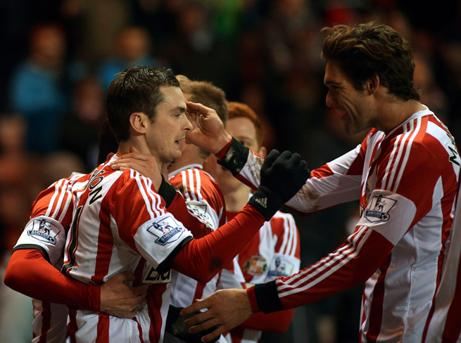 Adam Johnson, left, receives congratulations after his goal gave Sunderland a 1-0 lead over Stoke City on Wednesday.