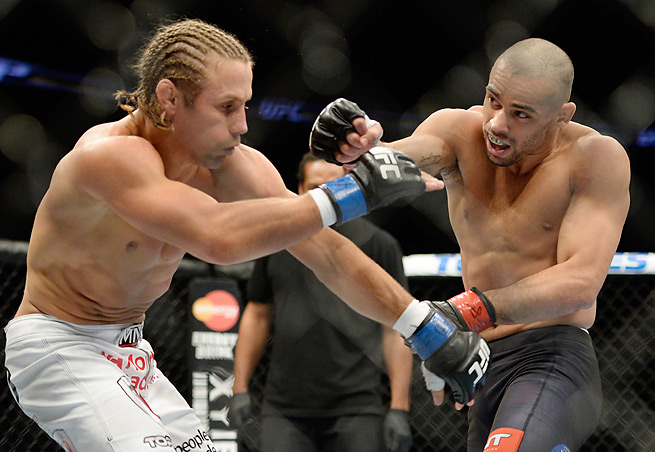 Renan Barao (right) remained unbeaten with a first-round TKO of Urijah Faber at UFC 169.
