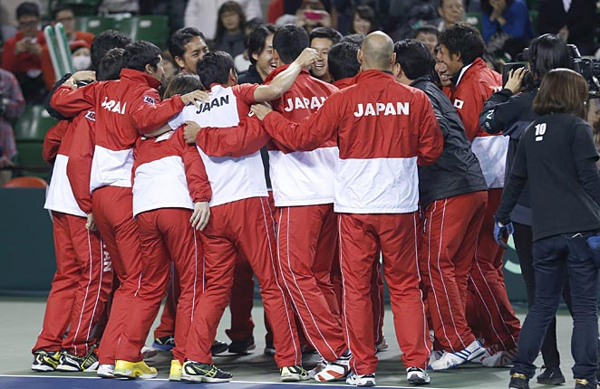 Japan knocked Canada out of the Davis Cup Sunday after Frank Dancevic was forced to retire in the second set of his match.