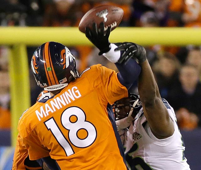 Cliff Avril hits Peyton Manning as he releases the ball, leading to a underthrown pass that was intercepted.