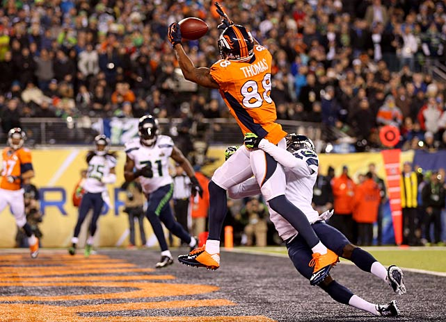 Demaryius Thomas pulls in a touchdown pass on a night when he set the Super Bowl record for receptions in a game (13).