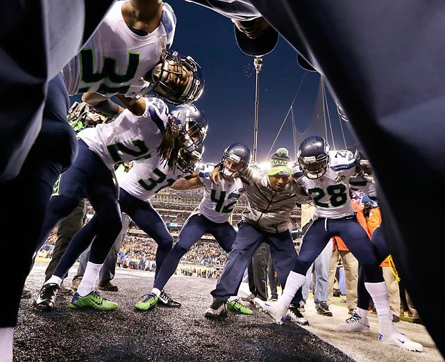 Members of the Seattle Seahawks defensive backfield huddle during warmups prior to Super Bowl XLVIII against the Denver Broncos.