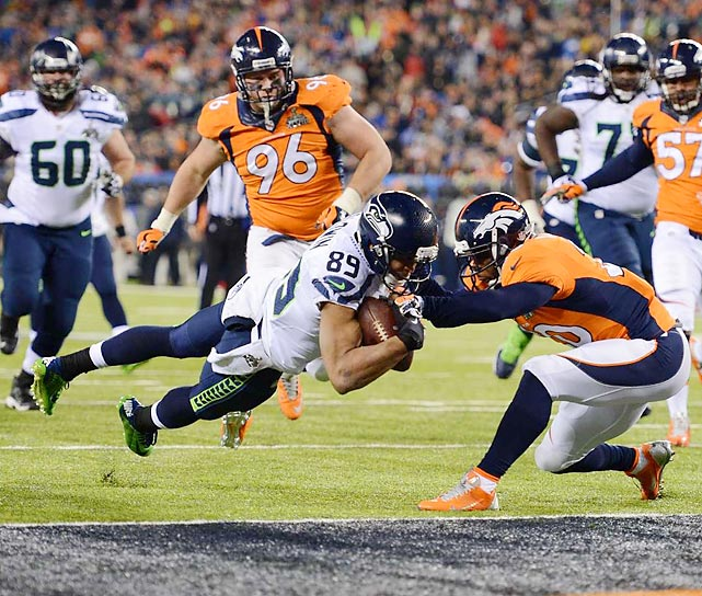 Seattle wide receiver Doug Baldwin dives into the end zone for a touchdown during the fourth quarter of Super Bowl XLVIII. Baldwin's touchdown gave the Seahawks a 43-8 lead.
