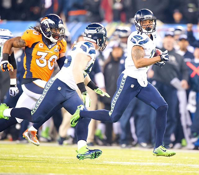 Seahawks receiver Percy Harvin dashes toward the end zone as he returns the opening kickoff of Super Bowl XLVIII's second half for a touchdown. Harvin's 87-yard touchdown and the ensuing extra point gave Seattle a 29-0 lead.