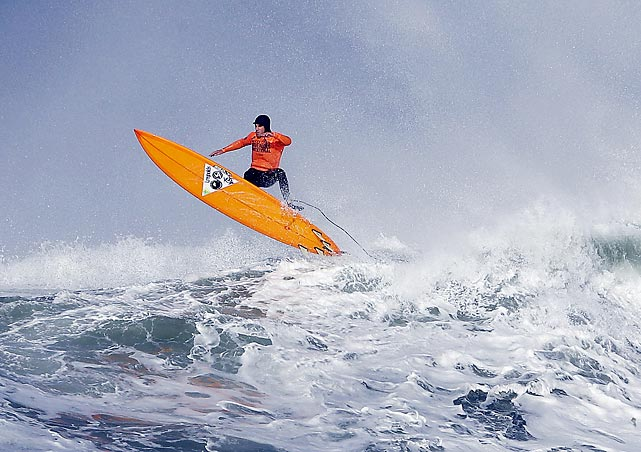 Tyler Fox glides above a wave during the Mavericks Invitational big wave surf contest. The competition took place in Half Moon Bay, Calif.
