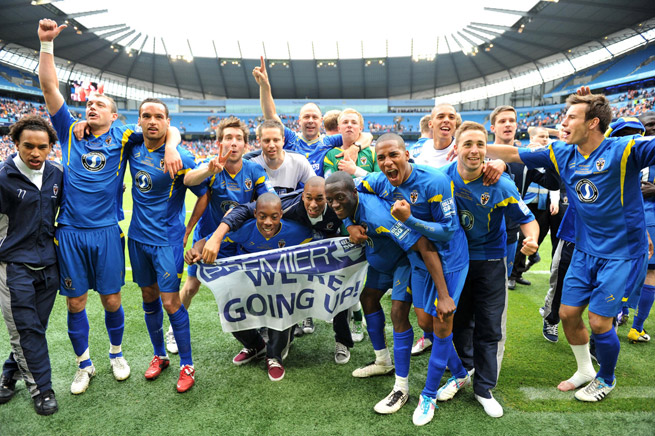 AFC Wimbledon celebrates gaining promotion to the Football League in 2011 after defeating Luton Town at City of Manchester Stadium.