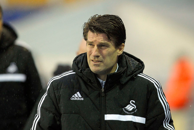 Swansea City parted ways with manager Michael Laudrup on Tuesday.