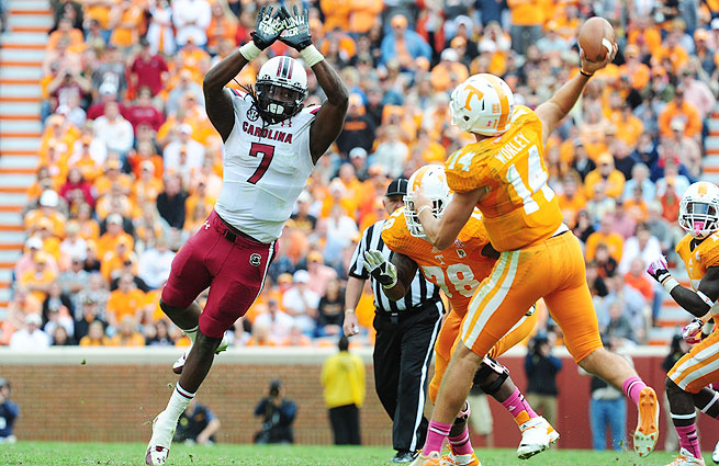 Jadeveon Clowney (left) saw his stats plummet in 2013, but scouts aren't concerned about the decline.