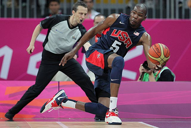 Durant looks to save the ball in a preliminary round Olympic game against Tunisia.