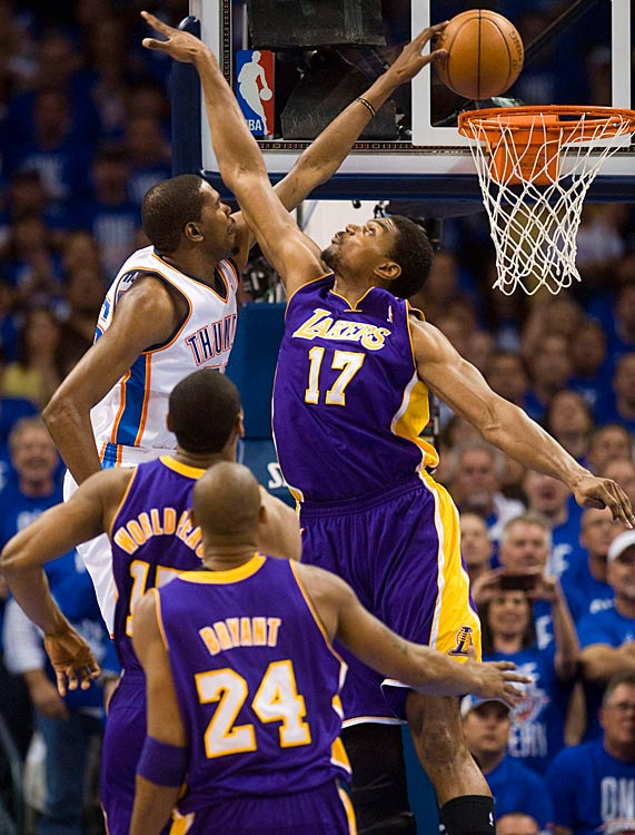 Kevin Durant dunks past the Lakers' Andrew Bynum during Game 1 of the Western Conference semifinals.