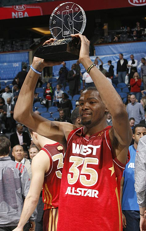 Kevin Durant with the MVP trophy after the West defeated the East 152-149 in the All-Star game.