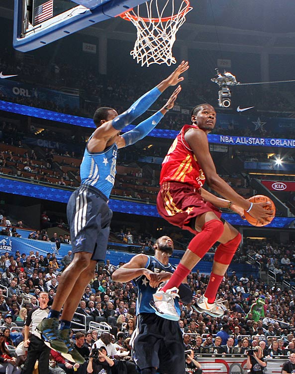 Dwight Howard goes up to try to defend a shot by Durant during the All-Star game in Orlando.
