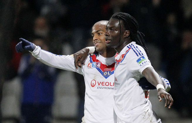 Lyon's Bafetimbi Gomis, right, celebrates with Jimmy Briand after scoring in the semifinals of the Coupe de la Ligue against Troyes on Wednesday.