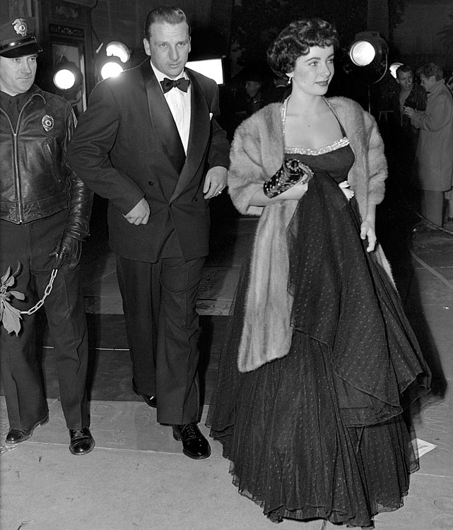 Elizabeth Taylor arrives for a Hollywood movie premiere with home run king Ralph Kiner on Dec. 21, 1949.