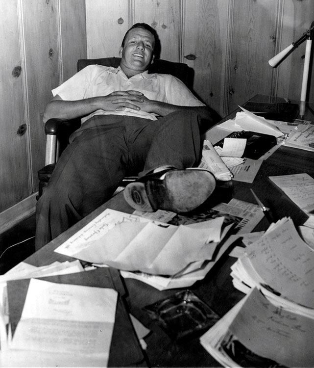 Ralph Kiner sits in his Palm Springs home as he awaits the decision from the Pittsburgh Pirates on his lateest contract demand and refusal to take a 25% pay cut on Jan. 27, 1953 in Palm Springs, Calif.