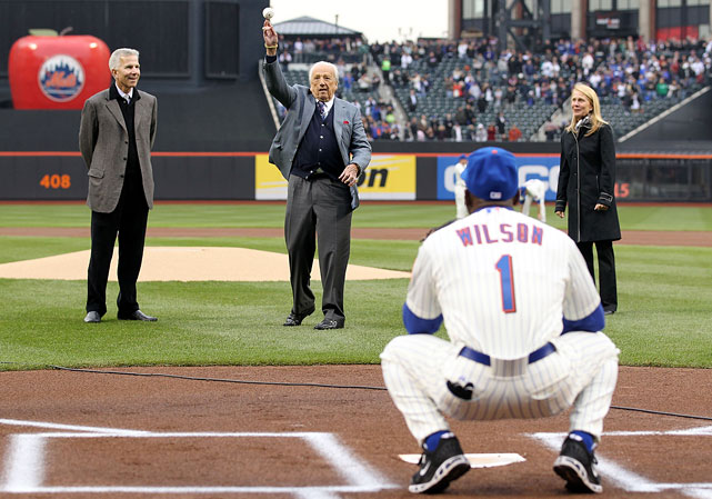 Ralph Kiner throws out the ceremonial first pitch to New York Mets first base coach Mookie Wilson prior to the Mets home opener against the Washington Nationals at Citi Field on April 8, 2011.