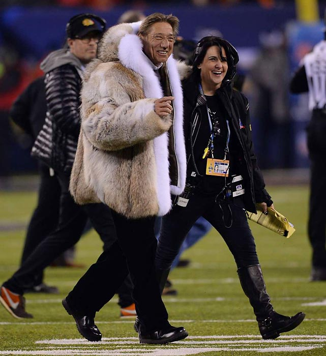 Never one to skimp on style, Broadway Joe incurred the wrath of the good folks at PETA by donning a large furry animal before he injected some levity into the Super Bowl by botching the ceremonial coin toss, which initially favored the Broncos but went the Seahawks' way on the re-flip, thus setting the tone for the day.
