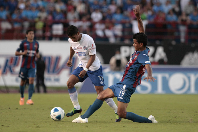 Cruz Azul's Joao Rojas, left, dodges a challenge from Atlante's Salustiano Candia in Sunday's Liga Bancomer MX match.
