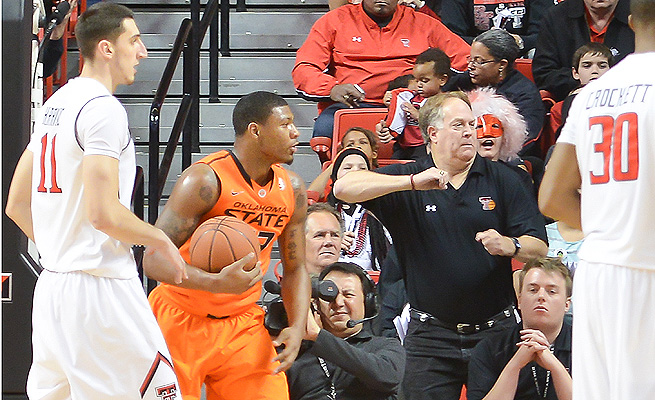 Marcus Smart shoved fan Jeff Orr (center) in the second half of Oklahoma State's loss to Texas Tech.