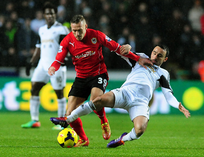 Cardiff City's Craig Bellamy (39) has been charged with violent conduct for appearing to punch Swansea City's Jonathan de Guzman in Saturday's derby.