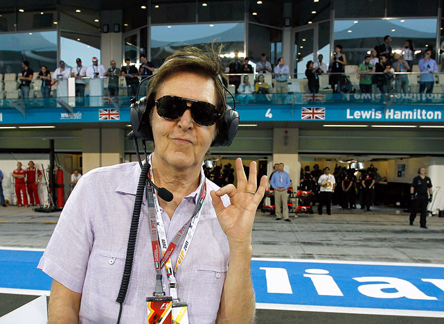 Sir Paul McCartney looks to work with a pit crew during qualifying for the Abu Dhabi Formula One Grand Prix at the Yas Marina Circuit.