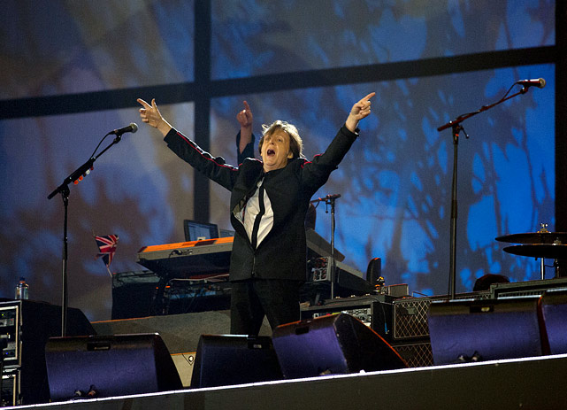 Sir Paul McCartney points to the crowd at Olympic Stadium in London during the opening ceremony of the 2012 Summer Olympics.