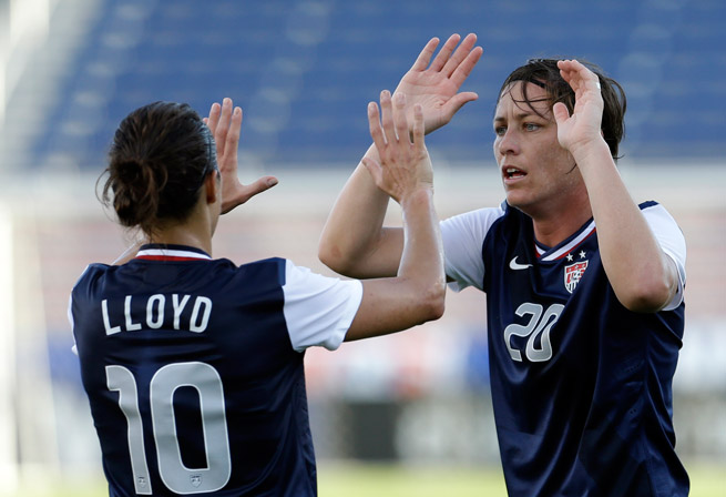 U.S. women's stars Carli Lloyd and Abby Wambach will have to wait an extra day to take on Russia in their second of two friendlies.