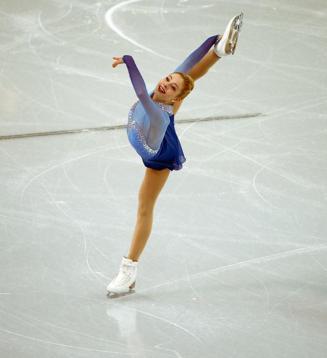 U.S. figure skater Gracie Gold contorts herself while participating in the team ladies free skating competition in Sochi. Gold finished in the second position, helping the Americans earn bronze in the team competition.