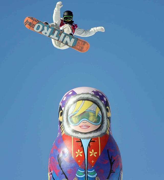 A competitor jumps during the men's snowboarding slopestyle finals at the Winter Olympics.