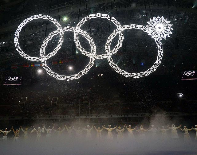 Illuminated rings expand to reveal the traditional Olympic rings. One of the rings, however, failed to expand.