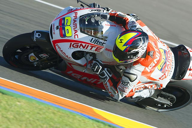 Colombian motorcycle racer Yonny Hernandez rounds a turn during the MotoGP of Valencia Free Practice in Spain.