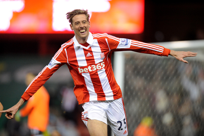 English forward Peter Crouch celebrates his opening goal in Stoke City's 1-1 draw with Swansea City Wednesday.